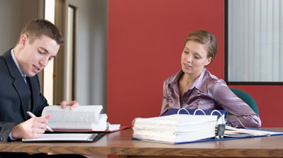 Photo of two people doing paperwork